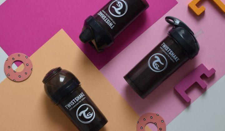 Biberones de la marca Twistshake con fondo de colores rosas y naranjas, ayuda para la lactancia
