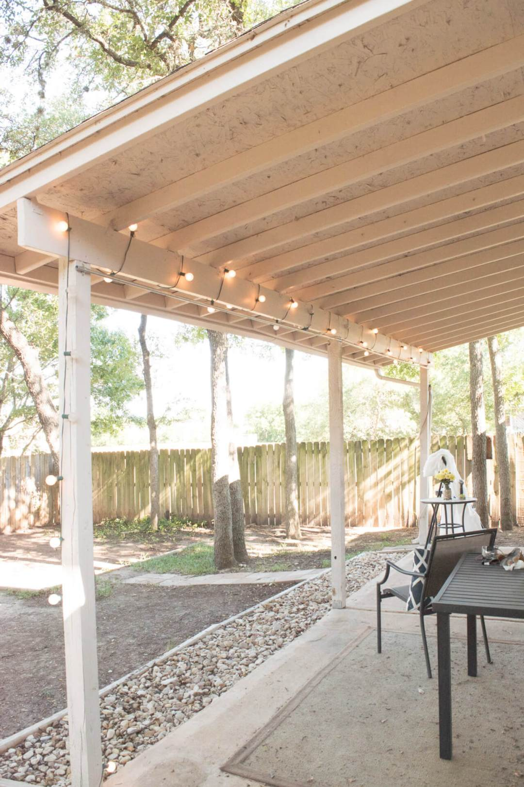 Backyard patio conduit pipe hung up with no curtains