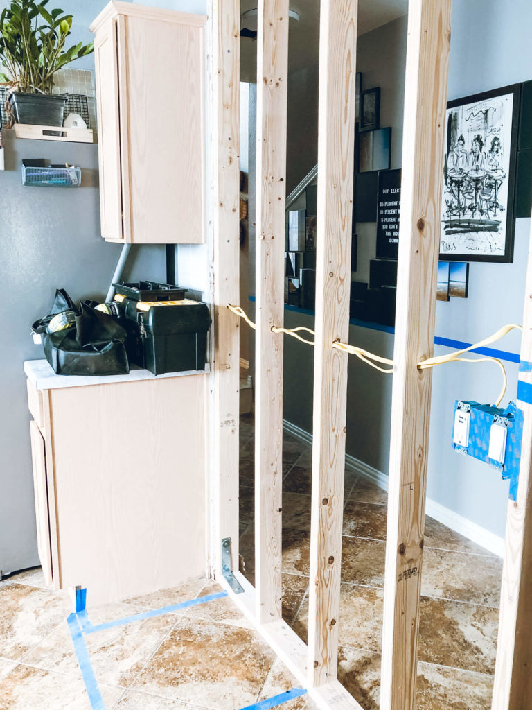 Wiring a three way switch works isn't too complicated, but it's something you definitely want to research beforehand. We installed some new three way switches during our kitchen remodel ourselves and saved a ton of money.
