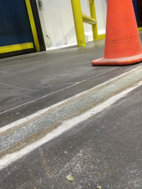Concrete Mender™ Spalled Control Joint Repair in progress.