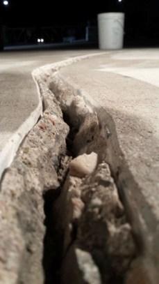 Crack in concrete floor ready for repair with Roadware 10 Minute Concrete Mender.