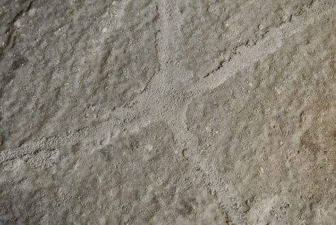 Finished MatchCrete Clear repair with matching sand color in a stamped concrete slab.