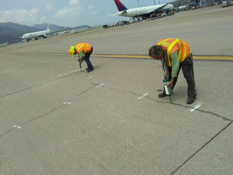Crews use Roadware Flexible Cement II in 600ml cartridges to quickly repair concrete cracks in a taxiway at HKG airport.