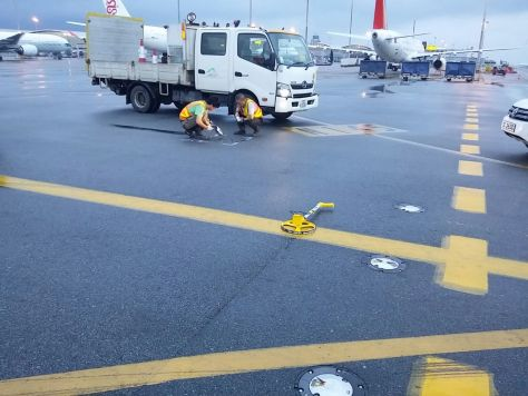 HKG crews use Flexible Cement II to seal cracks near an in-ground refueling port in damp conditions.