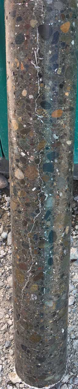 """A 24"""" deep core sample shows 100% injection repair with Roadware 10 Minute Concrete Mender."""