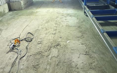 Heavily dusted concrete floor in a freezer warehouse.