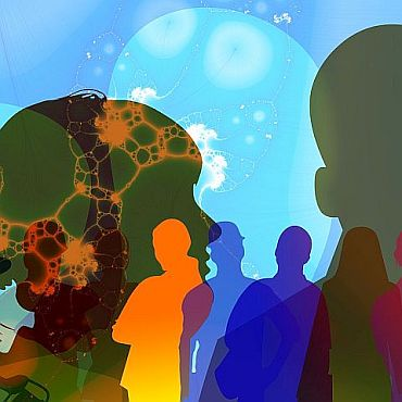 Graphic image showing silhouettes of people in multiple primary colours with cellular structures and a light blue big bubble background
