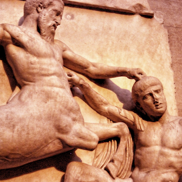 Parthenon North Frieze XXIX Centaur pushing naked man down, man is hitting back upwards with his right fist as he kneels under lifted front hoofs. Coloured reddish.