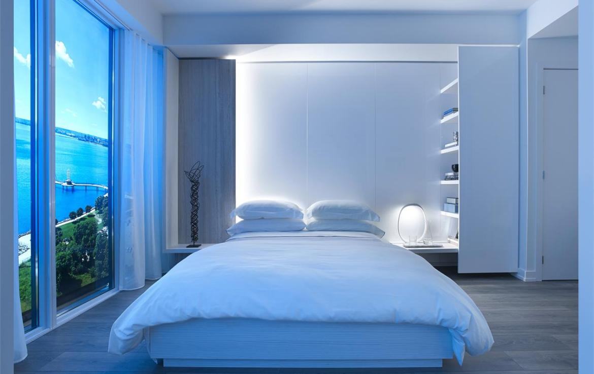 Rendering of Nautique Lakefront Residences suite bedroom at night.