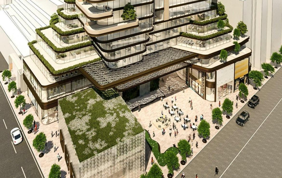 Aerial rendering of 33 Avenue Road Condos at base with lush greenery, retail and a major intersection.