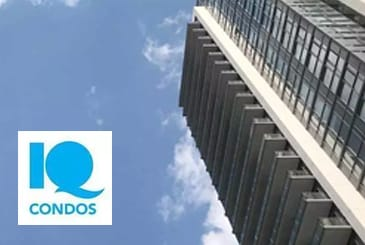 Exterior view of IQ Condos with logo overlay.