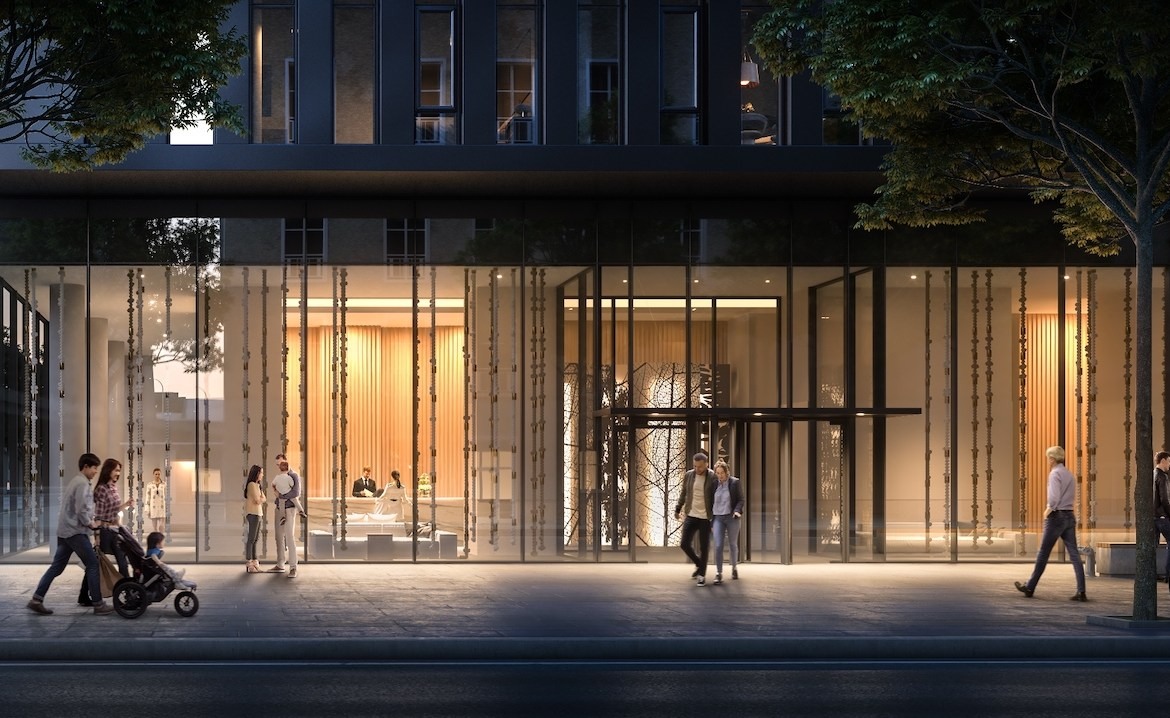Rendering of Sugar Wharf Condos lobby entrance exterior view at night.