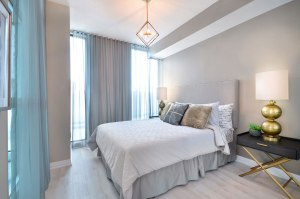 Interior rendering of Perla Towers condo suite bedroom.