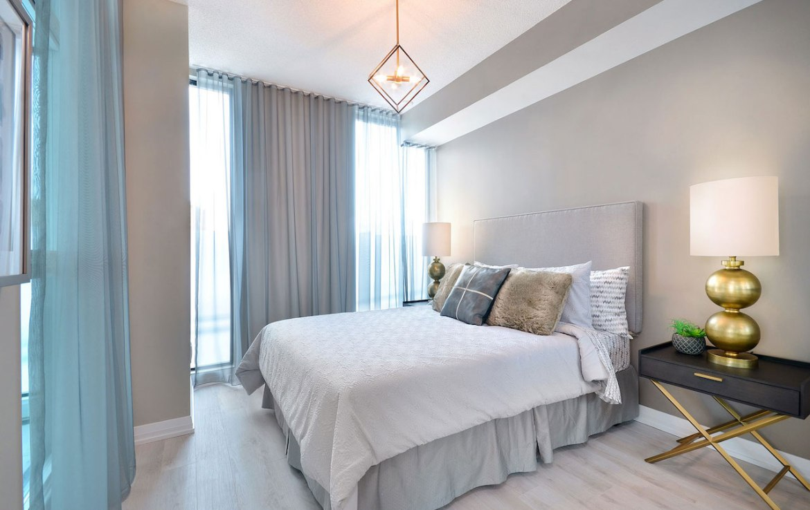 Interior rendering of Perla Towers condo suite bedroom.