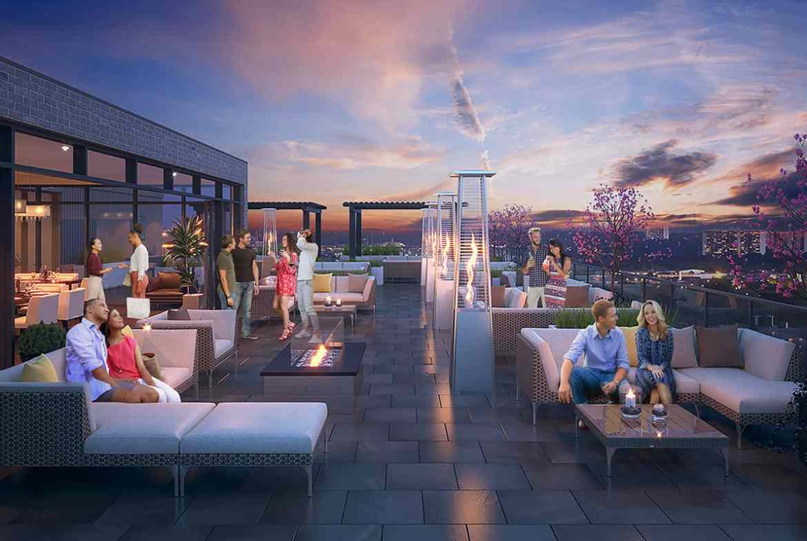 Exterior rendering of 8 Haus Boutique condos rooftop terrace at dusk.