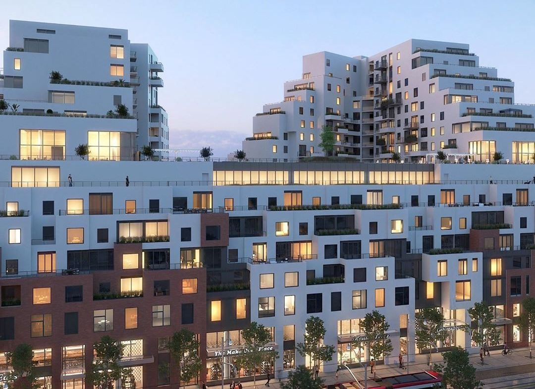 Exterior rendering of Queen & Ashbridge Condos building side at night.