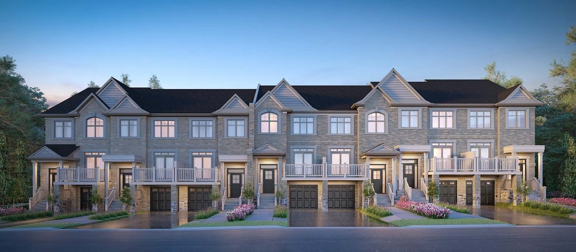 Exterior rendering of King East Estates townhomes at night.
