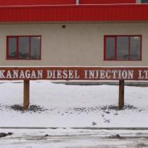 sand caeved /blasted log sign for okanogan diesel injection ltd. Vernon Bc