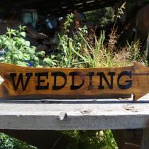 sandblasted cedar wood directional sign made by Condor signs