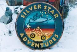 custom cedar sandblasted business sign for Silver Star Adventures Vernon bc,snowshoeing,skiing,atv,snow mobiles,skating,nordic,alpine,