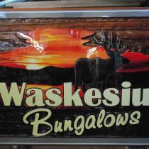 sandblasted development sign for Waskesiu Bungalows Prince Albert National Park in northern Sask.