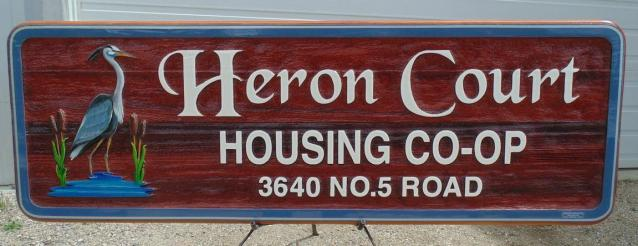 Sand carved, artist painted and handcraft quality Cedar sign by Condor signs Vernon BC For Heron Court Housing Co-op Vancouver BC