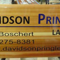 Davidson Pringle Lawyers cedar wood golf course ad board