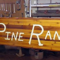 Lone pine ranch cedar wood sign after repair and restoration by Condor Signs Vernon BC.