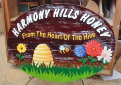 Sand blasted or sand carved artist painted cedar sign for Harmony Hills Honey in Kamloops BC.Condor signs makes business signs of all kinds
