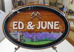 wooden house sign foe Ed&June custom made and artist painted sandblasted cedar sign by Condor signs Vernon BC