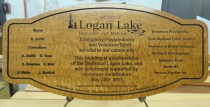 Wood dedication plaque Logan Lake Fire Hall in quilted maple.Custom made by Condoe signs Vernon BC