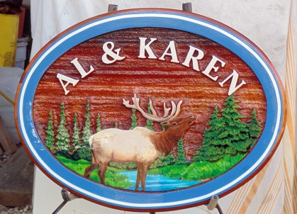 Recreational sign for a fine couple who own an elk farm in Sask.Custom made designed and constructed of sand blasted cedar by Condor Signs Vernon BC