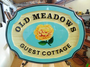 Old Meadows guest house in the mission area of Kelowna BC Sandblasted cedar wood sign hand painted.By Condor signs Vernon BC