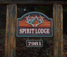 Spirit Lodge bed and breakfast wood sign sandblasted and artist painted.Located in Vernon BC custom made by Condor signs.