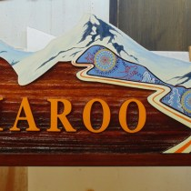 Australian aboriginal art sandblasted cedar sign for Silver Star Resort Vernon BC rental property by Condor Signs.
