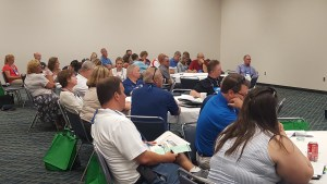 Attendees attentively listen in to the employment issues presentation.