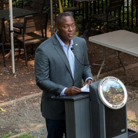 Howard County Executive Calvin Ball speaks at a podium