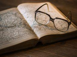 black-framed-eyeglasses-on-map book-159743