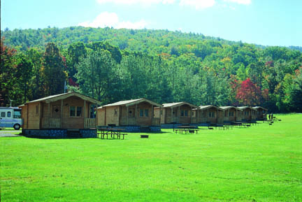 Aspen log cabin kit by Conestoga on campground
