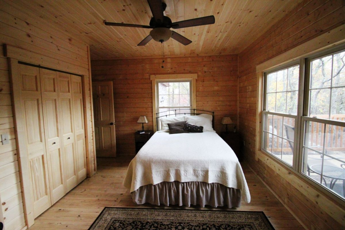 log home master bedroom with closet