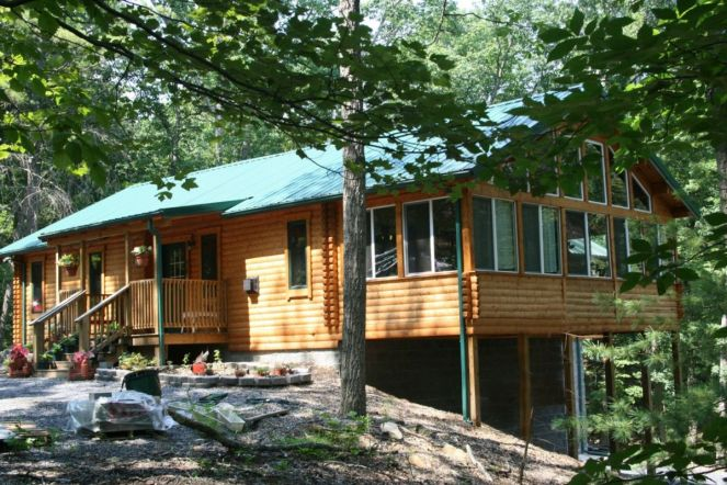 log home with sun porch