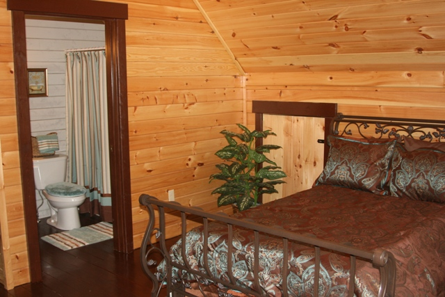 log home master bedroom with bathroom