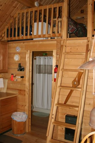 small log cabin ladder to loft