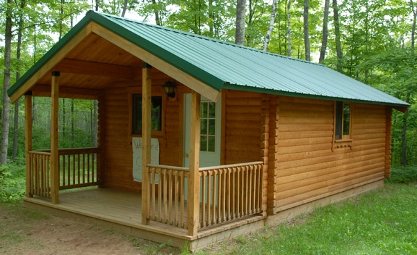 Affordable cabin kits for resorts getaway commercial log for Camping cabin kits