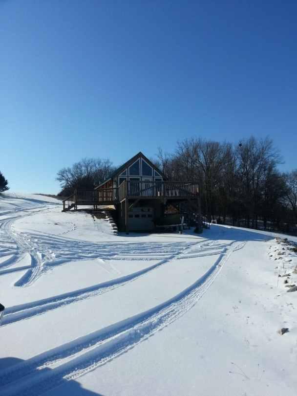 Heritage Conestoga log cabin in snow