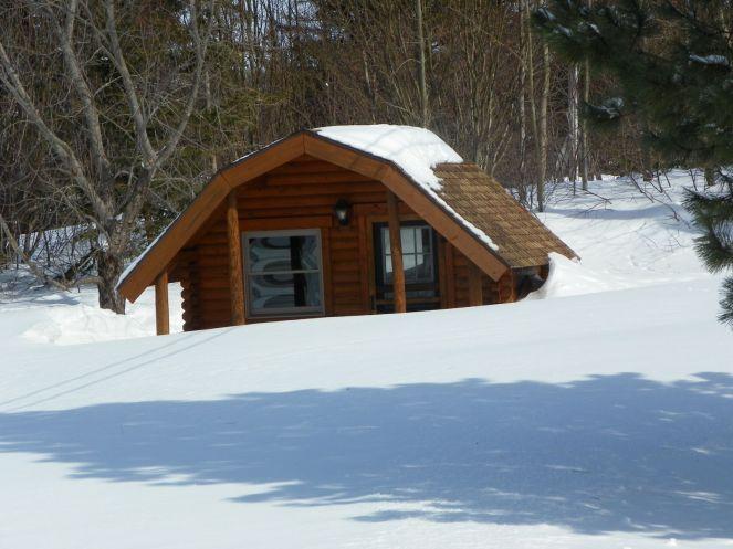 KOA campground log cabin in snow