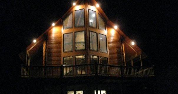Log Cabin Home Lights at Night