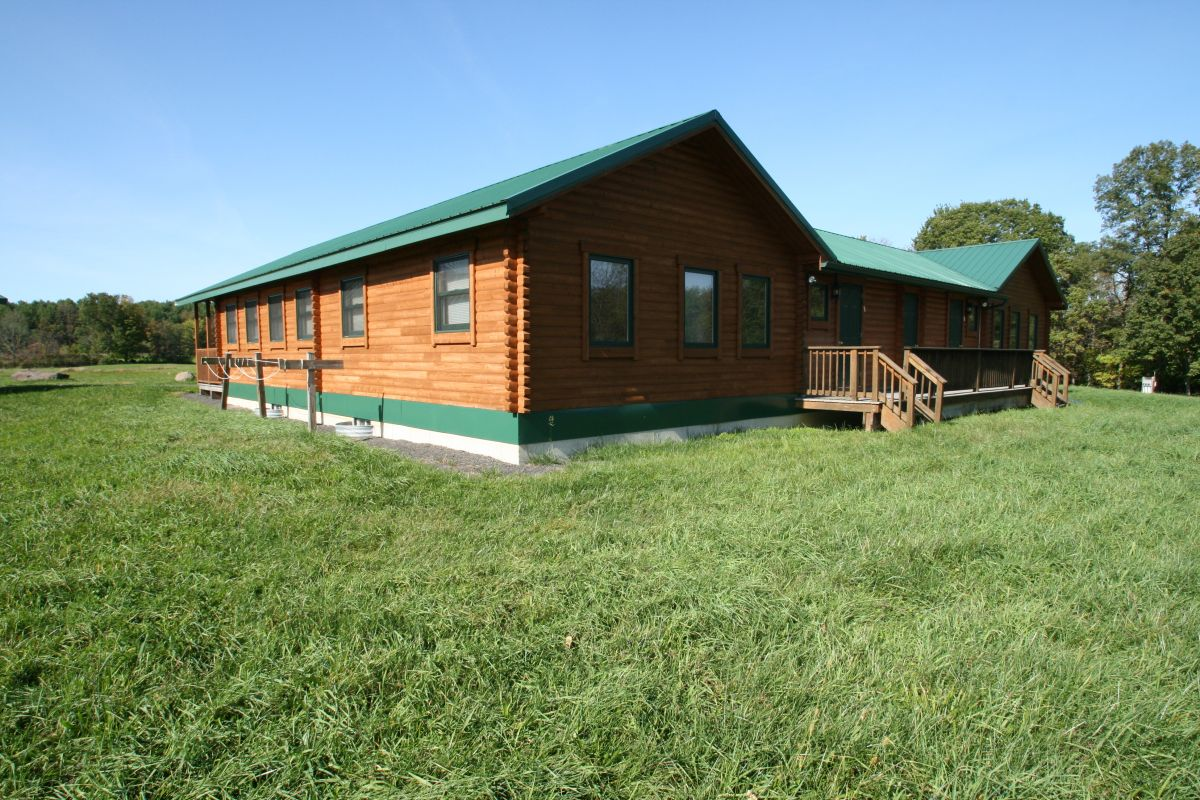 Bunkhouse cabins tranquility bunkhouse conestoga log for Bunk house kits
