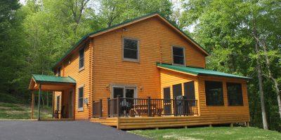 bear den log home exterior side