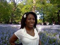 Monique Lewis in field of flowers